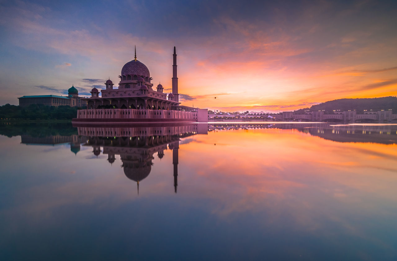 Putra mosque during sunrise Architecture Beauty In Nature Building Exterior Built Structure Calm Cloud Cloud - Sky Dome Idyllic Lake Malaysia Nature Orange Color Place Of Worship Putrajaya Reflection Scenics Sky Standing Water Sunset Symmetry Tranquil Scene Tranquility Water Waterfront