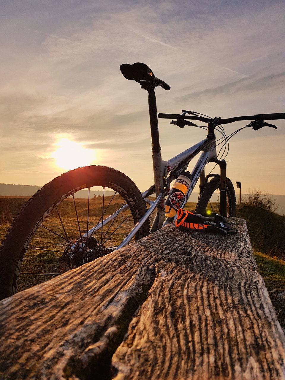 bicycle, transportation, mode of transport, sunset, land vehicle, sky, outdoors, no people, nature, mountain bike, day