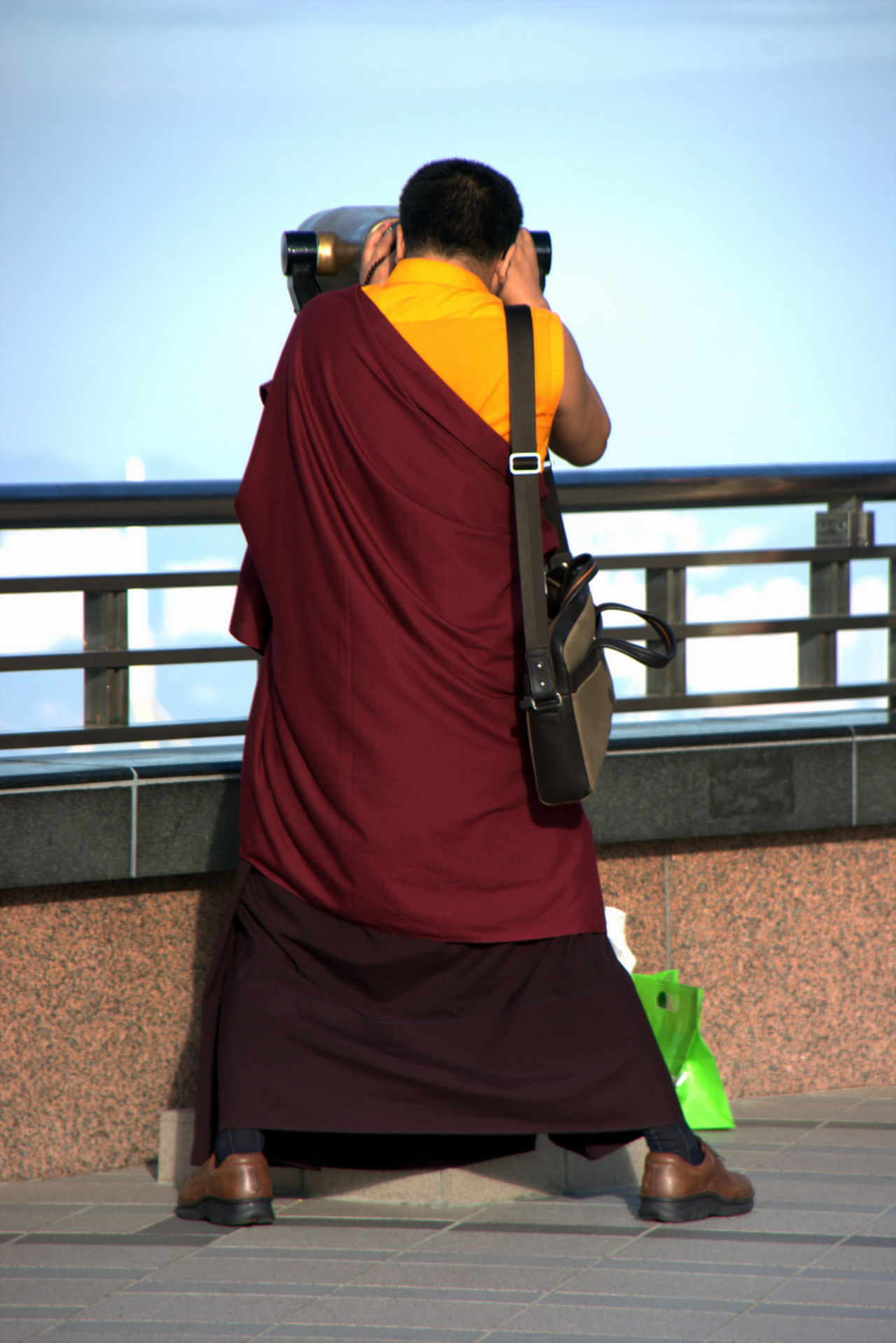 HK memories, 2009 Day Full Length Lifestyles Outdoors Railing Sky Buddhist Monks Monk  From The Back Modern Monk Telescope Enjoying The View People And Places Enjoy The New Normal