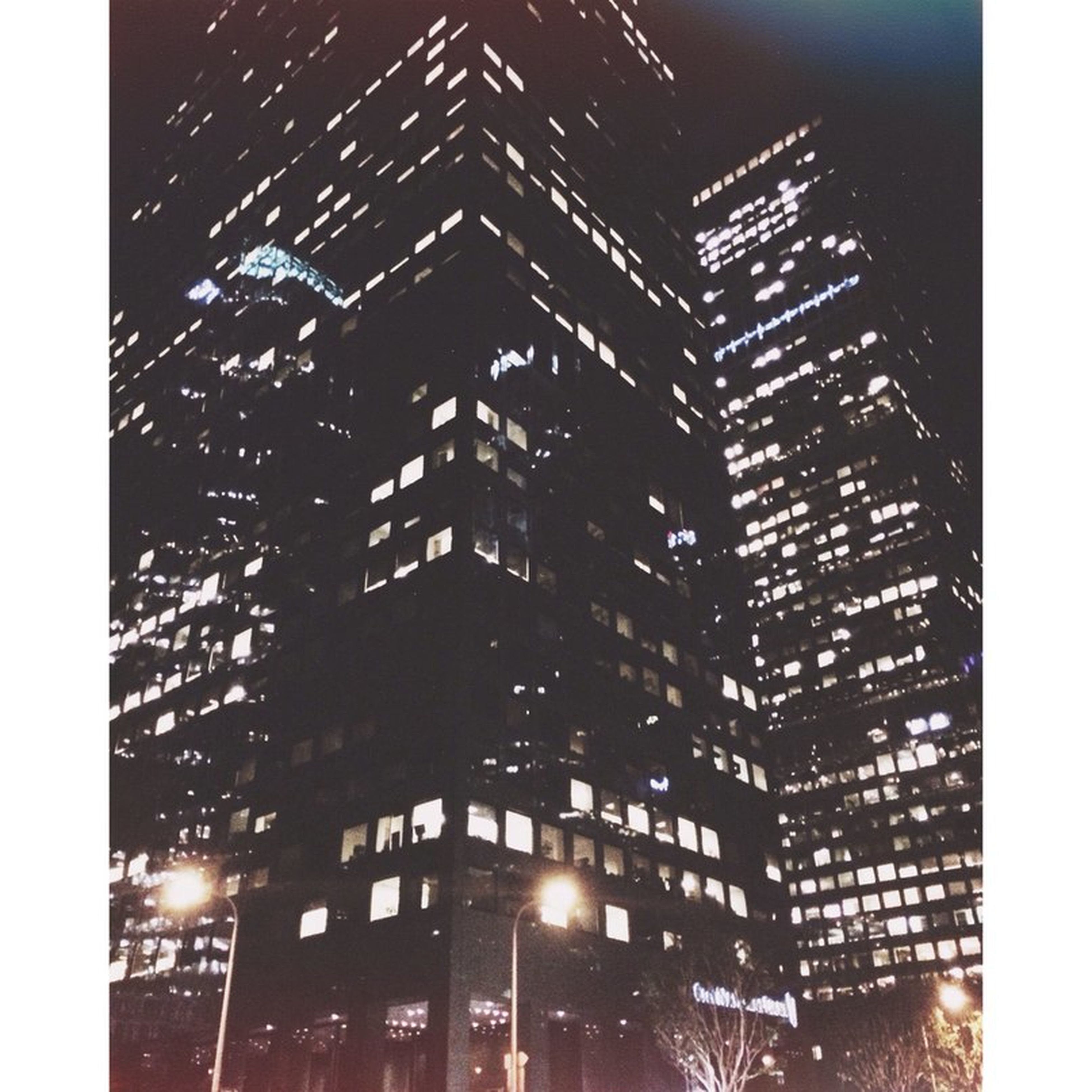 architecture, building exterior, built structure, low angle view, night, illuminated, city, transfer print, building, window, auto post production filter, skyscraper, office building, residential building, modern, residential structure, tall - high, sky, city life, tower