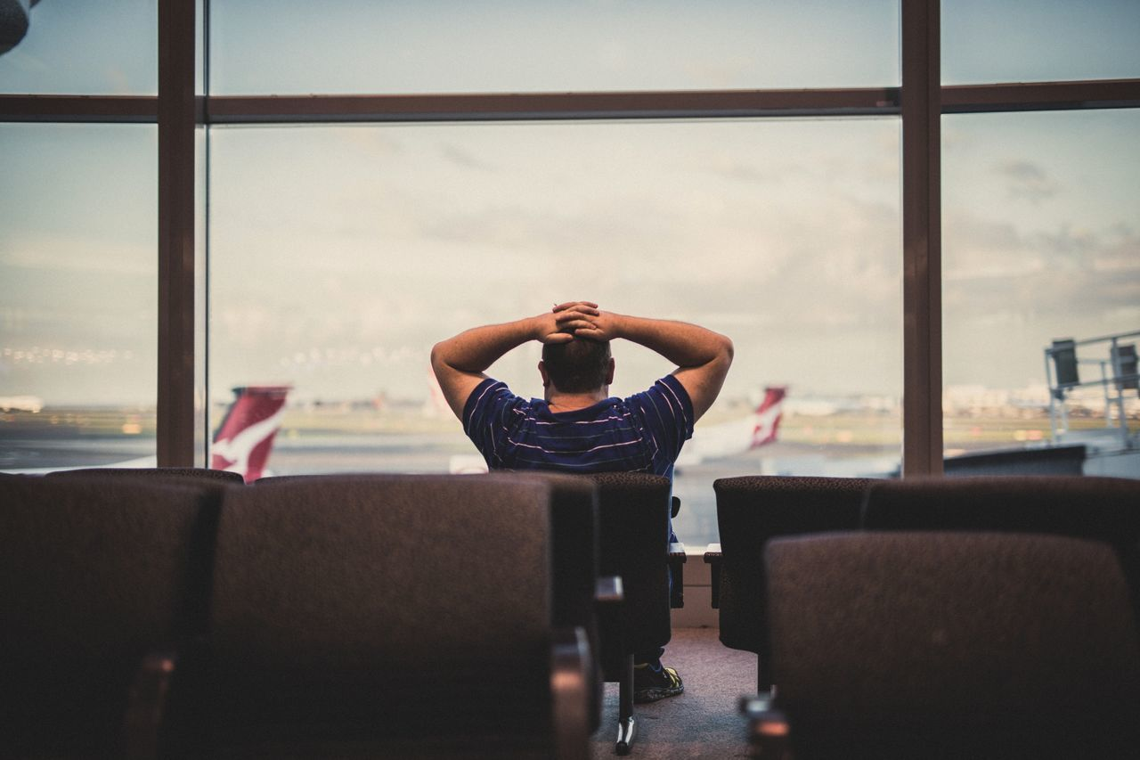 Traveling Home For The Holidays One Man Only One Person Dreaming Alone Traveling Showcase: December People Airport Airplane Waiting Traveling Home For The Holidays The Week On EyeEm