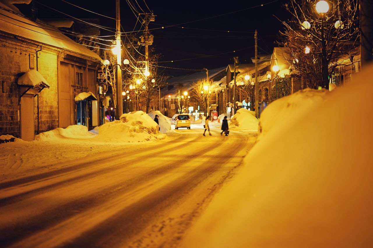 night, illuminated, street, built structure, street light, building exterior, architecture, electricity, transportation, car, cable, snow, road, outdoors, winter, cold temperature, city, nature, no people, sky