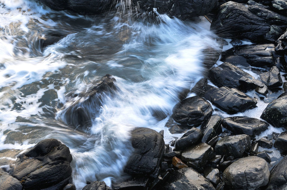 Wave hits the rocky shore on the Isle of Skye Beauty In Nature Coast Dark Flowing Flowing Water Highland Motion Nature No People Non Urban Scene Non-urban Scene Power In Nature Rock Rocks Scotland Sea Shore Shoreline Skye Splashing Tranquil Scene Water Wave Wave