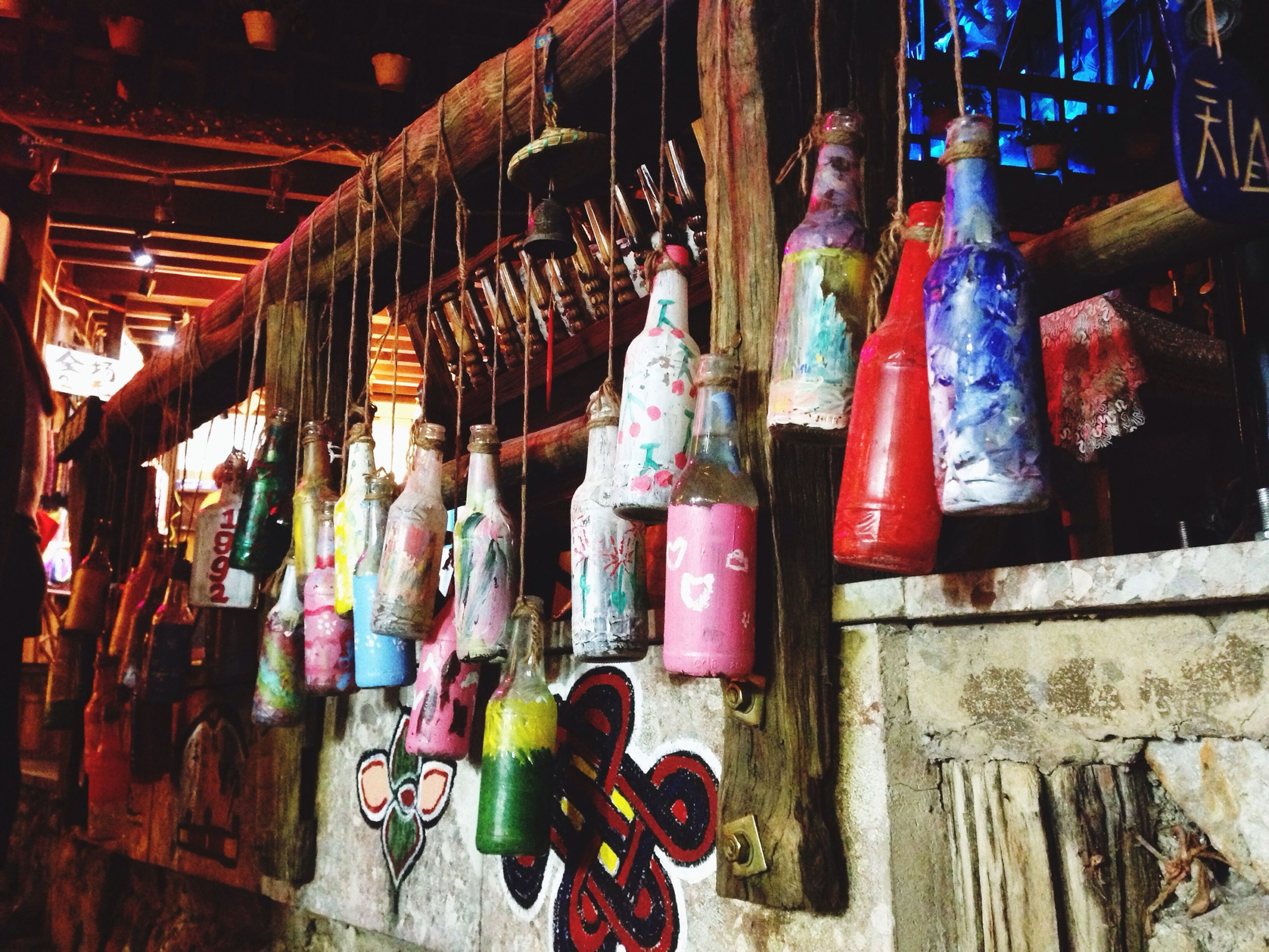 multi colored, for sale, retail, store, market, variation, market stall, choice, built structure, architecture, graffiti, large group of objects, in a row, hanging, abundance, art and craft, wall - building feature, arrangement, art, display
