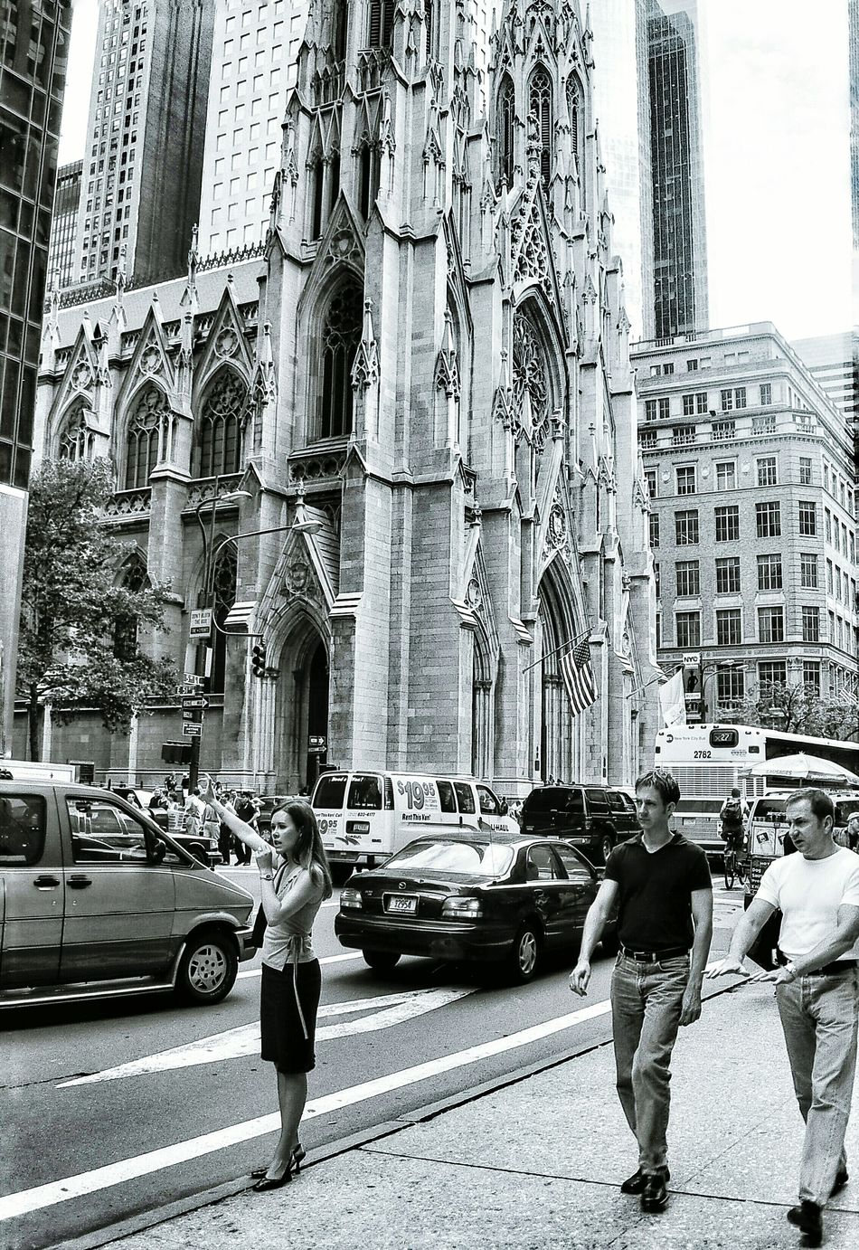 One of my early street photography captures. Captured in New York with St Patricks in the back ground. Love the animation of the characters. City Life Street Architecture On The Move Motion Street Photography Battle Of The Cities Streetphotography Streetphotography_bw New York New York City Blackandwhite Black And White Black & White Black And White Photography Church Architecture Churches Architecture Film Filmisnotdead Film Photography 35mm Film St Patrick's Cathedral Hailing A Cab New York Street Photography