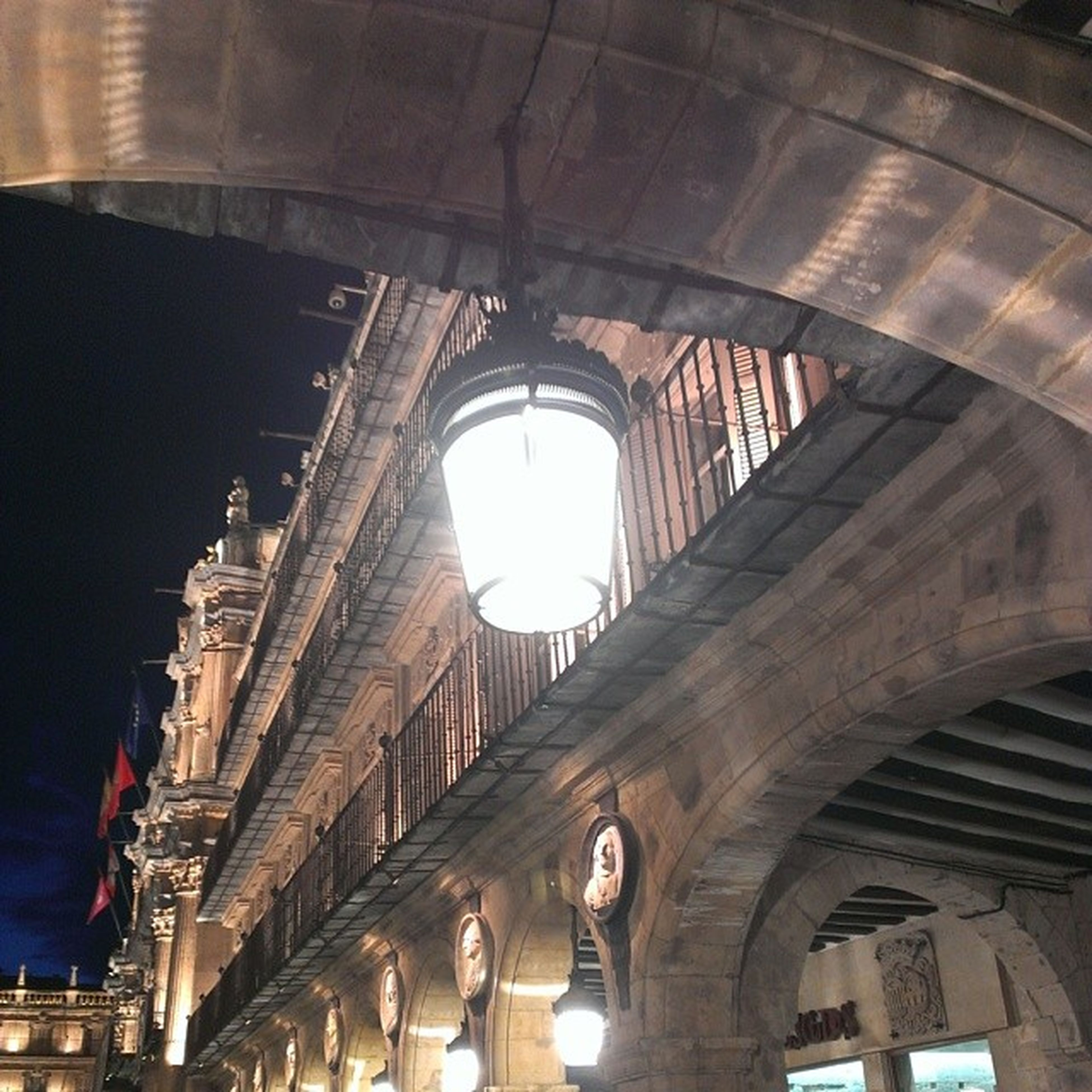 architecture, arch, built structure, low angle view, indoors, ceiling, architectural column, illuminated, interior, building exterior, history, building, column, lighting equipment, connection, tunnel, arched, bridge - man made structure, old, incidental people