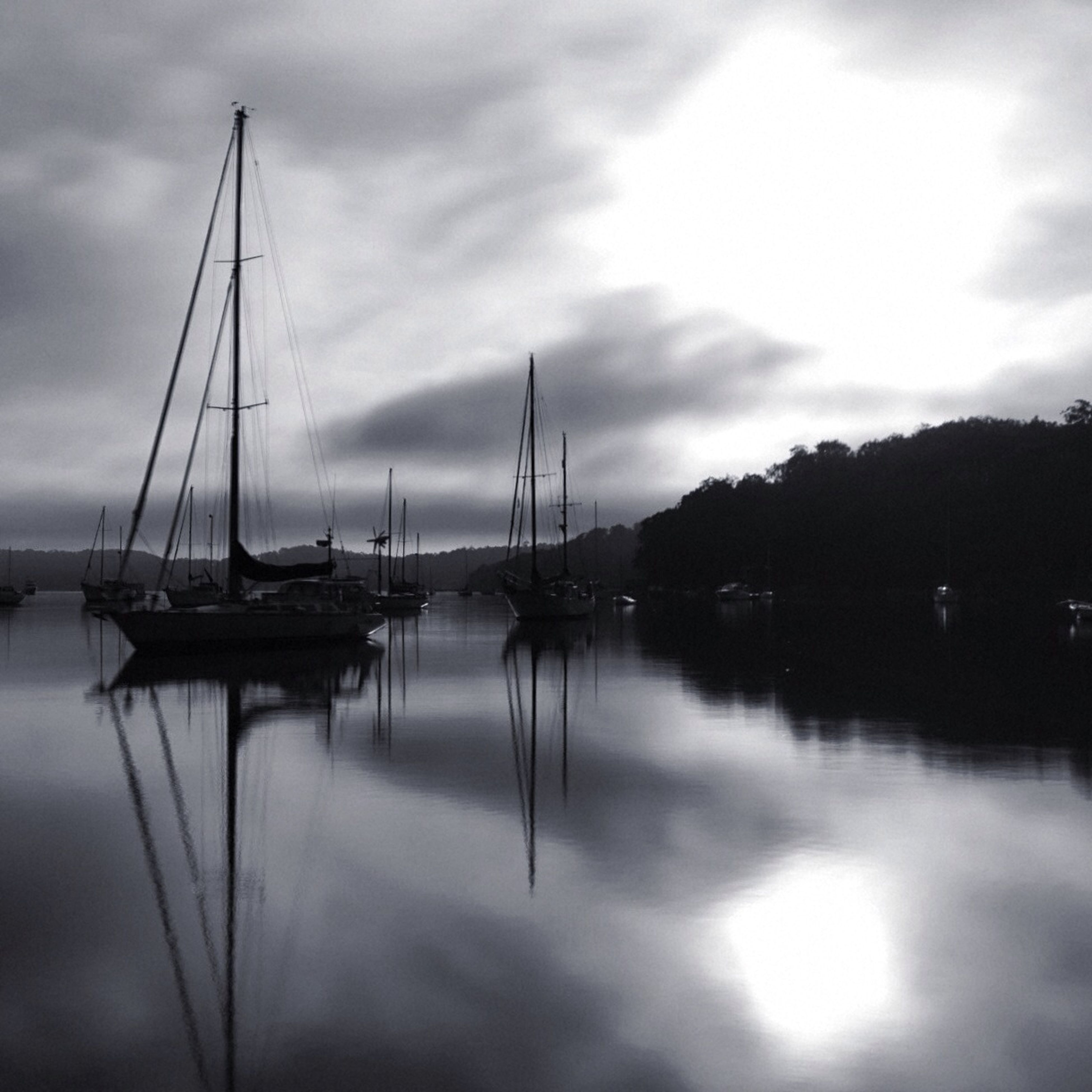 water, nautical vessel, sky, boat, transportation, moored, reflection, cloud - sky, mode of transport, tranquility, sea, tranquil scene, waterfront, mast, cloudy, lake, cloud, sunset, scenics, beauty in nature