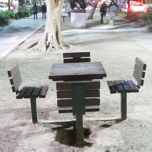 Pic nic chairs and table in a public area. Tel aviv Israel. Wood Table Chairs Pic Nic Public Square Outdoor Life