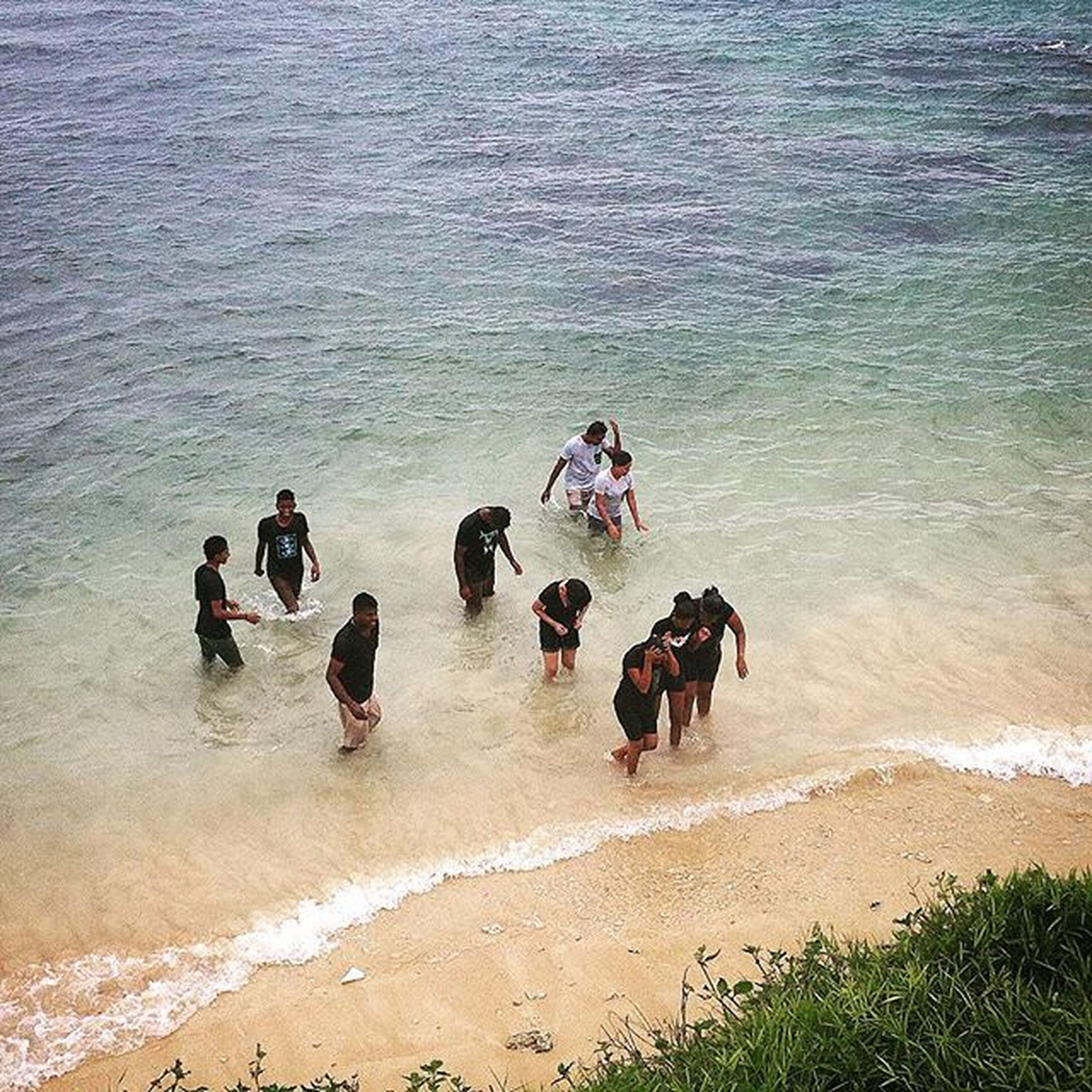 water, beach, sea, lifestyles, leisure activity, sand, vacations, men, shore, large group of people, enjoyment, high angle view, togetherness, person, nature, mixed age range, wave, medium group of people, weekend activities