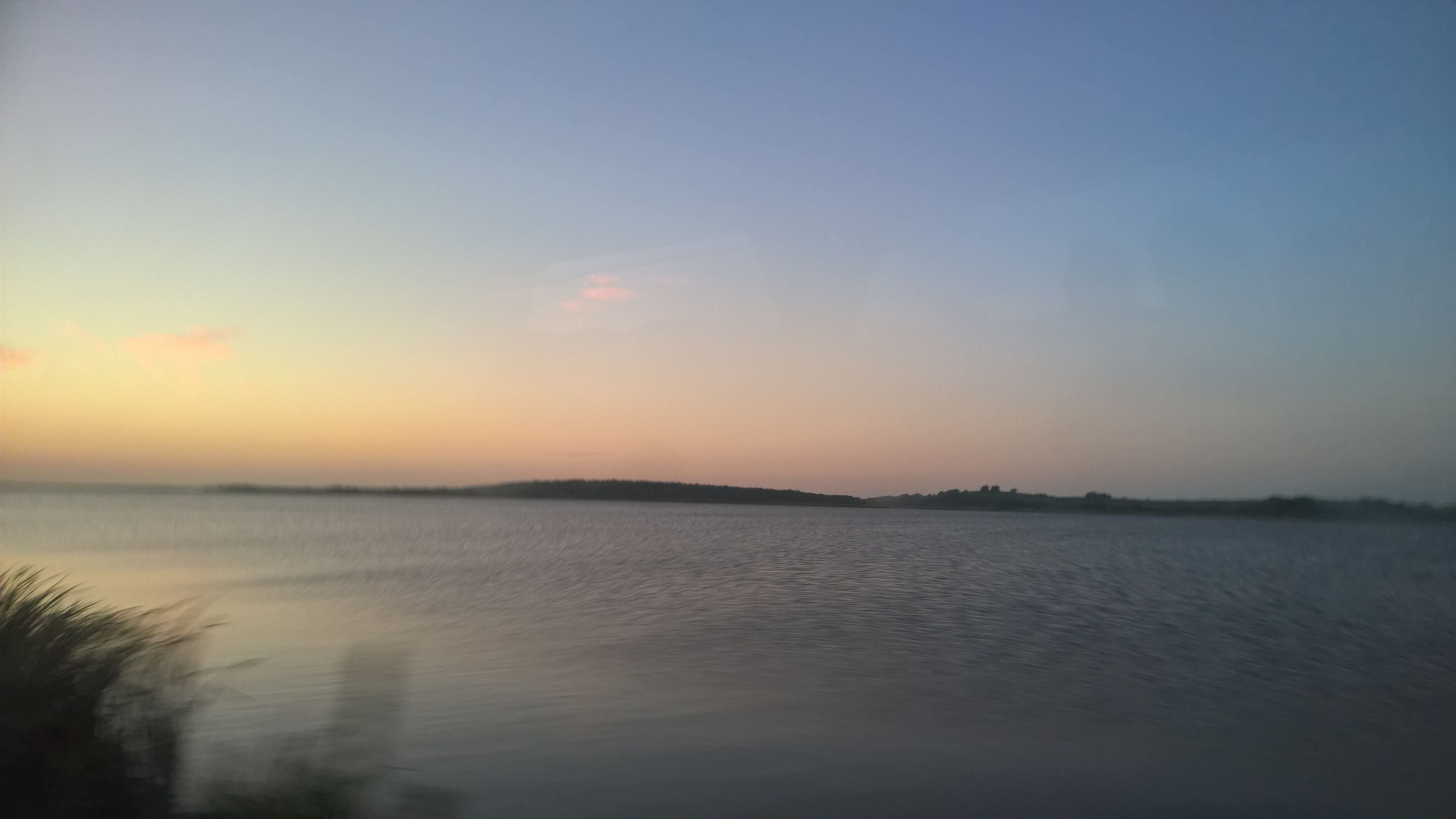 water, nature, tranquility, sky, tranquil scene, beauty in nature, reflection, sunset, scenics, no people, sea, outdoors, tree, day