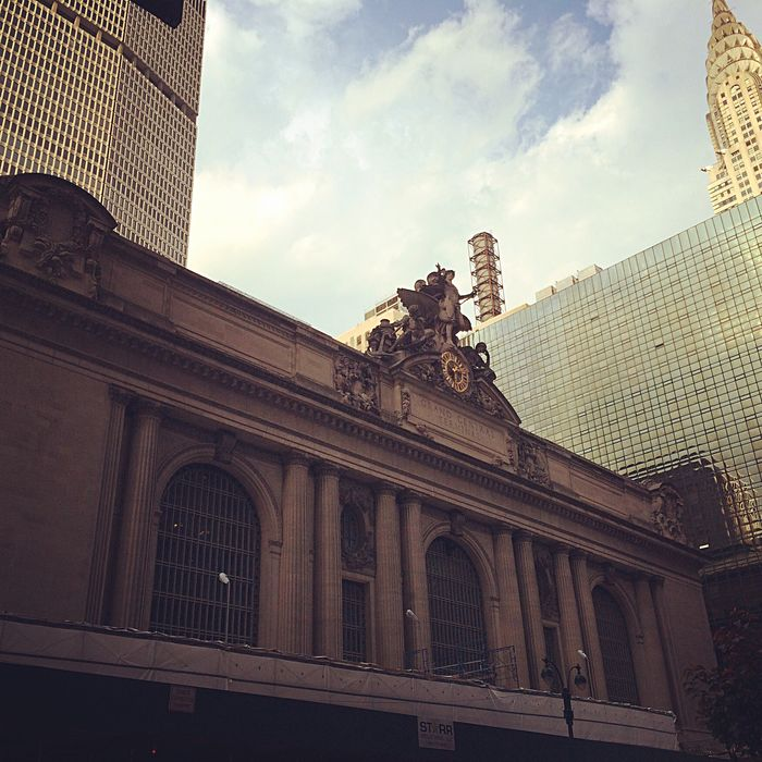 43 Golden Moments Gold Beautiful Lights Reflection Skyline Amazing Travel New York NYC Wanderlust Grand Central Station Walking Around Blue Sky Columns Architecture Building Gold Lights Sun Natural Light Golden Building Rule Of Thirds
