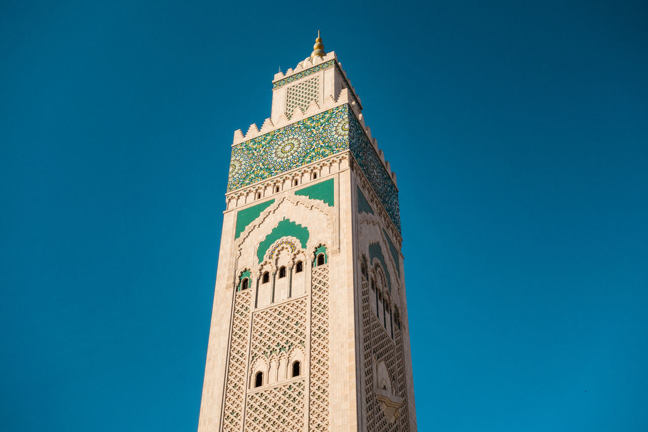 Architecture Blue Building Exterior Built Structure Casablanca City Clear Sky Day Design Hassan II Mosque Islamic Low Angle View Minaret Moroccan Morocco Mosque No People Outdoors Pattern Place Of Worship Religion Religion And Beliefs Sky Skyscraper Tower