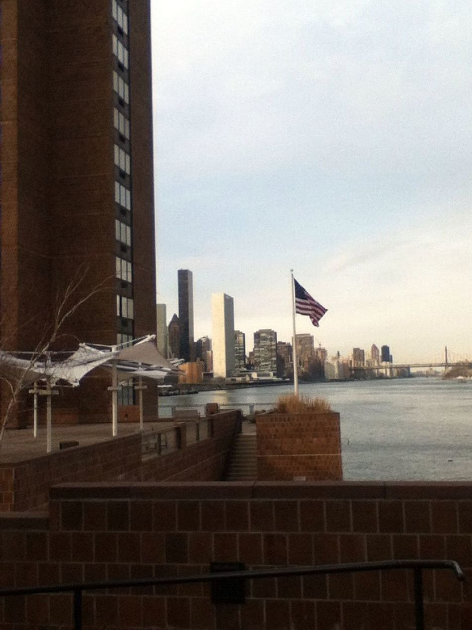 At waterside plaza taking a photo of the United Nations.