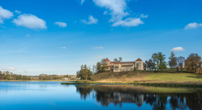 Swirhz castle 16th Century 16thcentury Antient Antient Castle Architecture Beauty In Nature Blue Built Structure Calm Castle Cloud - Sky Day Grass Area Lake Landscape Medieval Medieval Castle Nature Reflection Sky Standing Water Tranquility Trees And Sky Water Waterfront