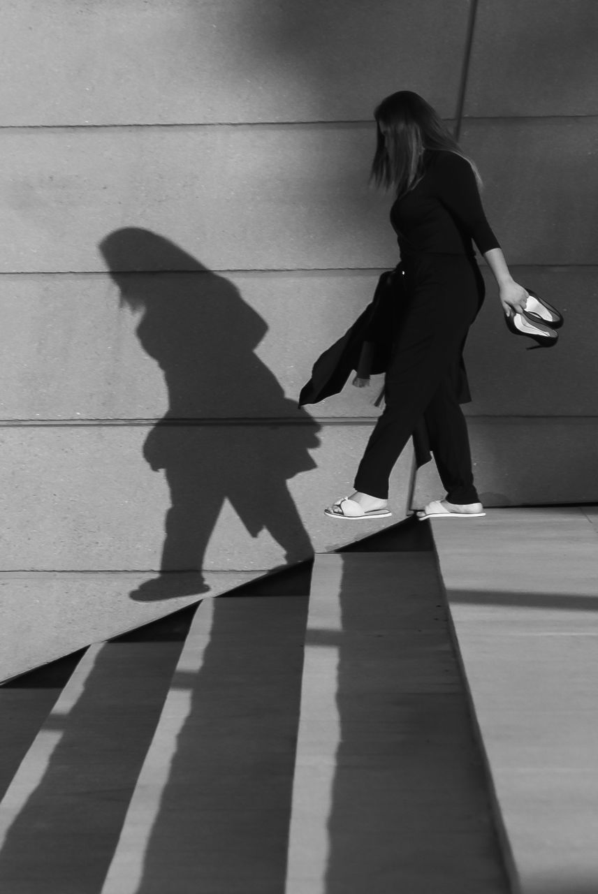 real people, shadow, full length, women, childhood, lifestyles, day, outdoors, young adult, young women, people
