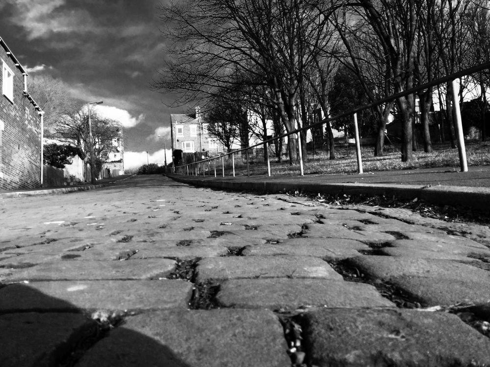 The view from below Blackandwhite Cobblestones Mexborough UK Noir