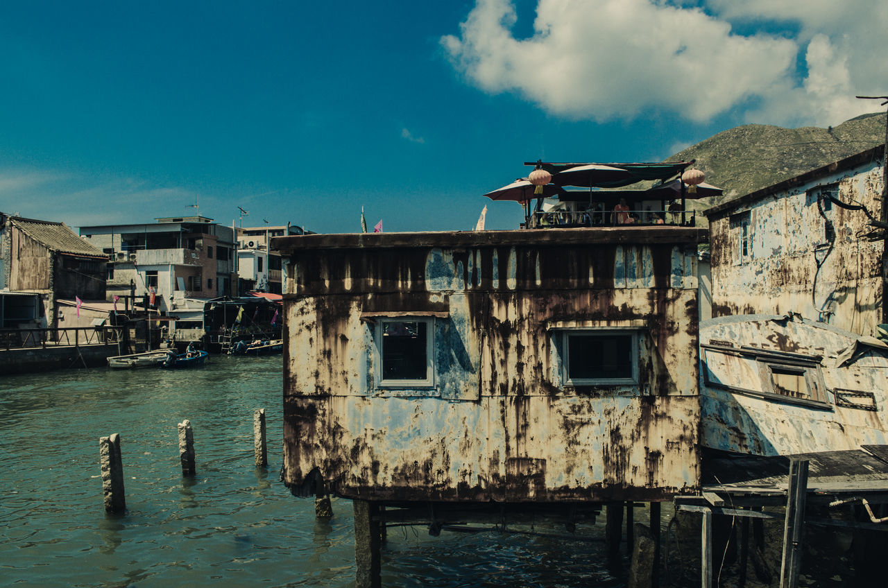 The water village of Hong Kong Architecture Building Exterior Built Structure Day Hong Kong House On The Hill Outdoors Sky Tai O Tai O Village Water Weathered