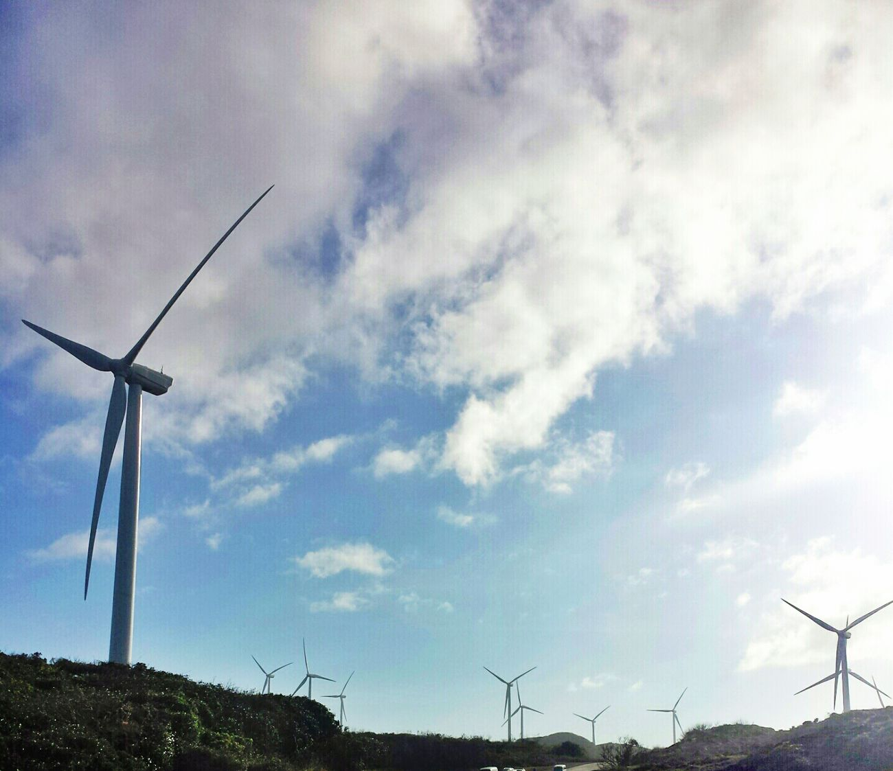 an army on mountains || Windmills Blue Sky Clouds And Sky Pilipinas