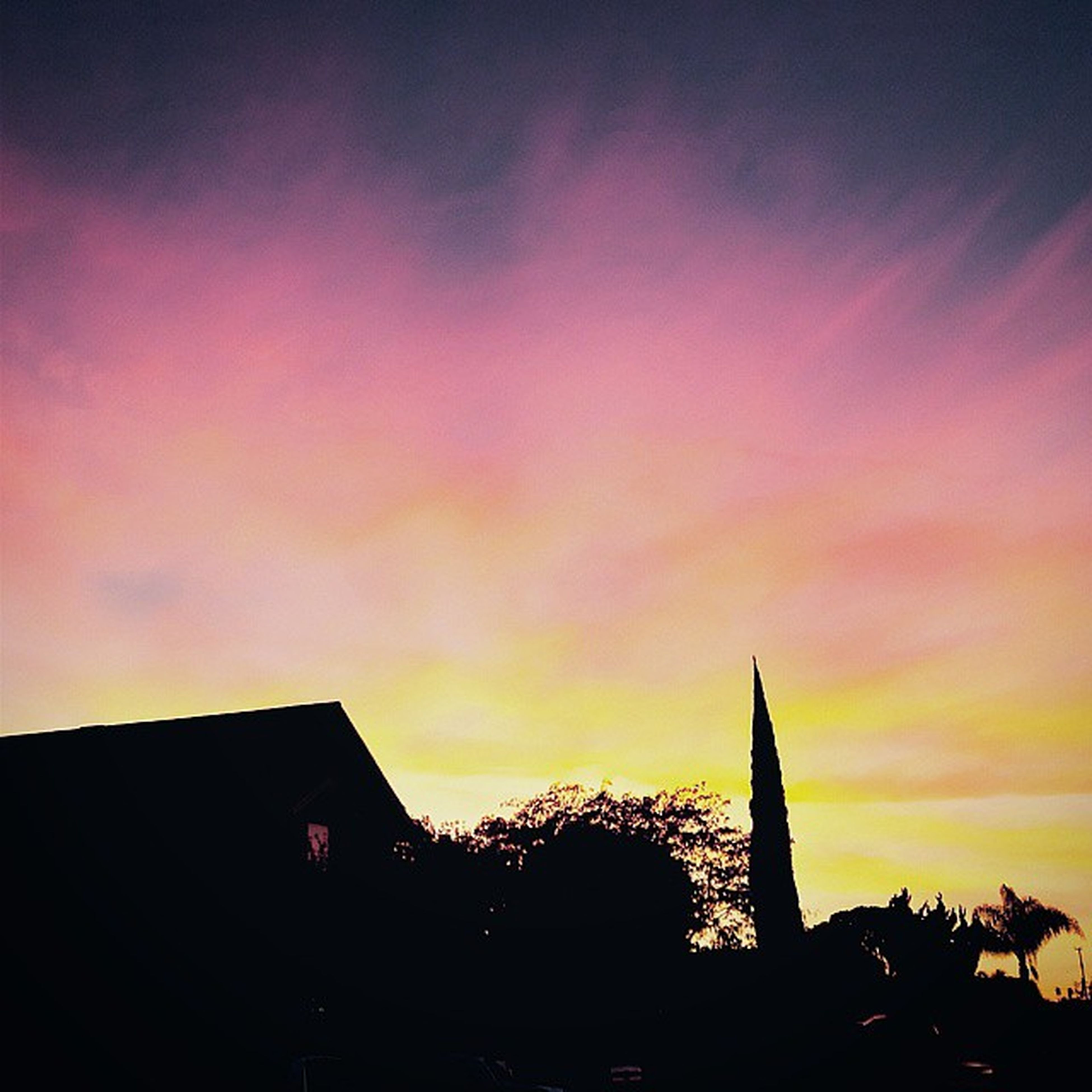 building exterior, architecture, built structure, sunset, silhouette, sky, low angle view, religion, place of worship, orange color, cloud - sky, high section, spirituality, church, outdoors, no people, cloud, dusk, house