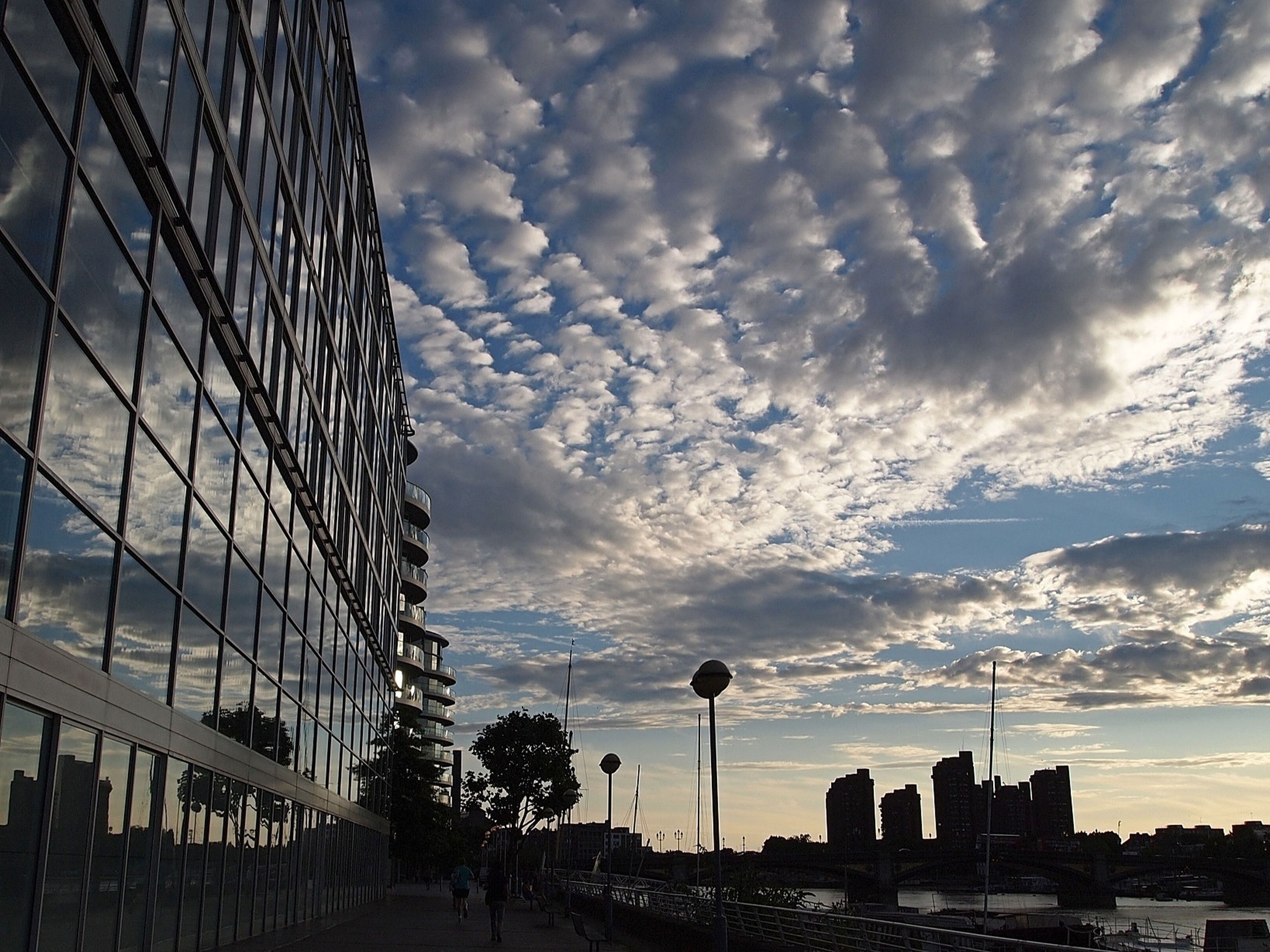 architecture, sky, built structure, building exterior, cloud - sky, city, cloudy, skyscraper, modern, cloud, cityscape, tall - high, office building, low angle view, building, tower, outdoors, no people, nature, day