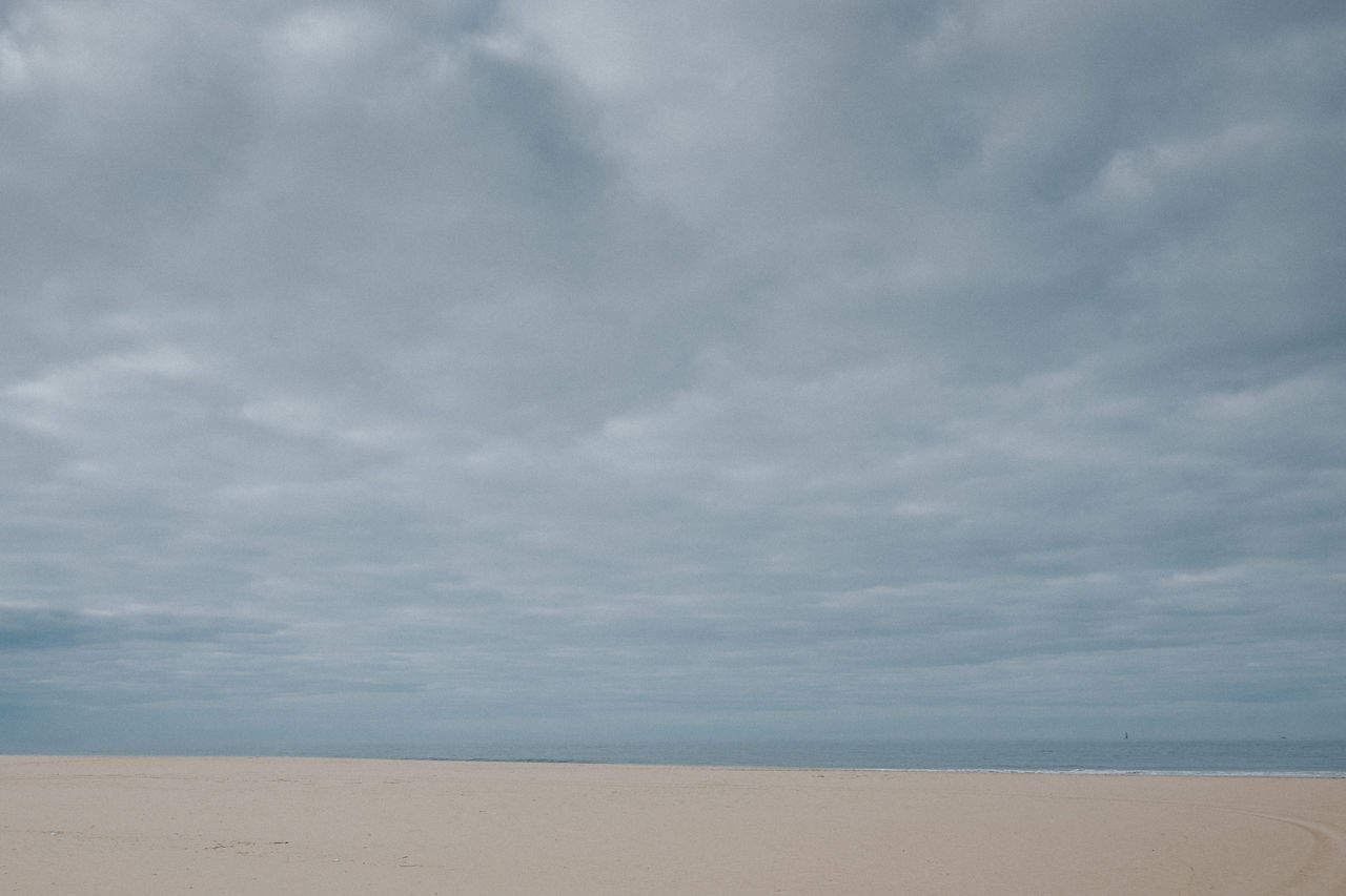 Beach Beauty In Nature Cloud - Sky Cloudy Day Grey Sky Horizon Over Water Landscape Minimal Minimalism Minimalistic Nature No People Outdoors Sand Scenics Sea Sky Tranquil Scene Tranquility Village Water