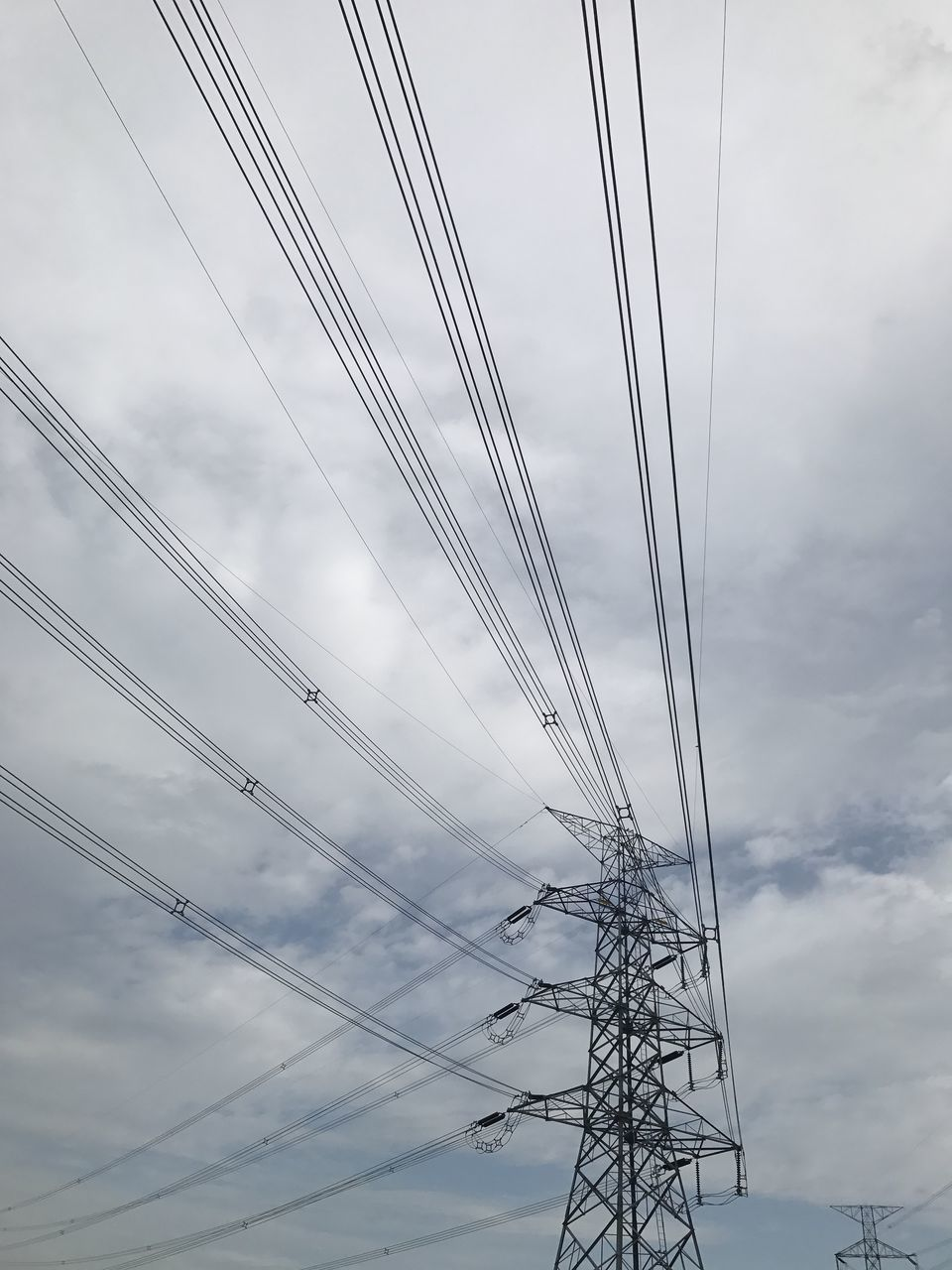 cable, connection, electricity, power supply, power line, technology, electricity pylon, fuel and power generation, sky, cloud - sky, low angle view, electricity tower, day, no people, outdoors, complexity