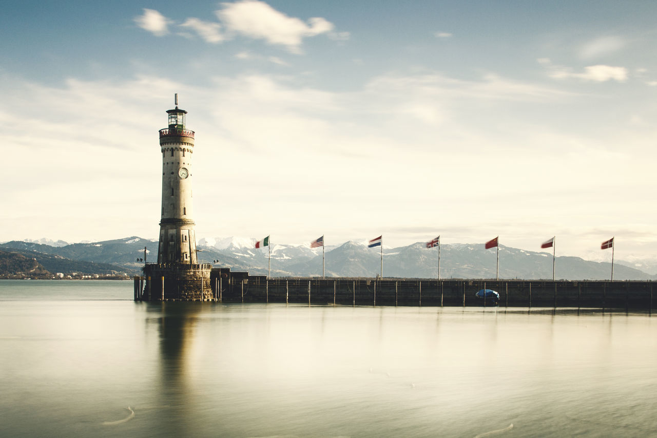 Alpen Austria Built Structure EyeEm Best Edits Eyeemphoto Germany Lakeofconstance Lighthouse Mountain Outdoors Reflection_collection Reflections In The Water Sky Sky_collection Tower Water Water Reflections Water_collection