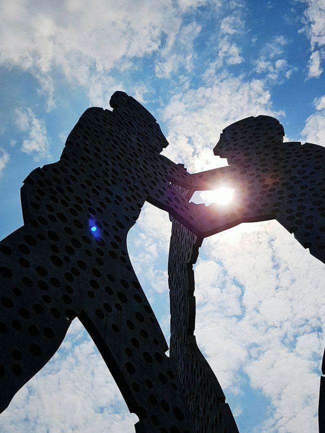Fusion Hidden Gems  Berlin Molecule Man River Spree Close Up EyeEm Best Shots Fighting Friedrichshain Kreuzberg Neukoln Check This Out From Below Statues Statue Towering Sky Cloud Belly Button