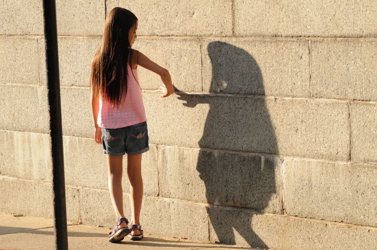 shadow, sunlight, real people, full length, outdoors, day, leisure activity, lifestyles, one person, young adult, people