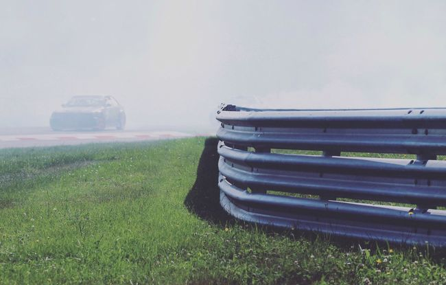 Car Drift Fence Fog Grass Grassland Grassy Green Color Land Vehicle Mode Of Transport No People Outdoors Smoke Track Transportation Visibility Weather