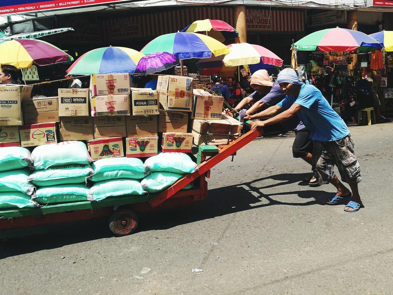 EyeEmPHLaborDay2017 Real People Market Street Men Outdoors Streetphotography Livelihood Carbon Market, Cebu HuaweiP9 DualLens Oo