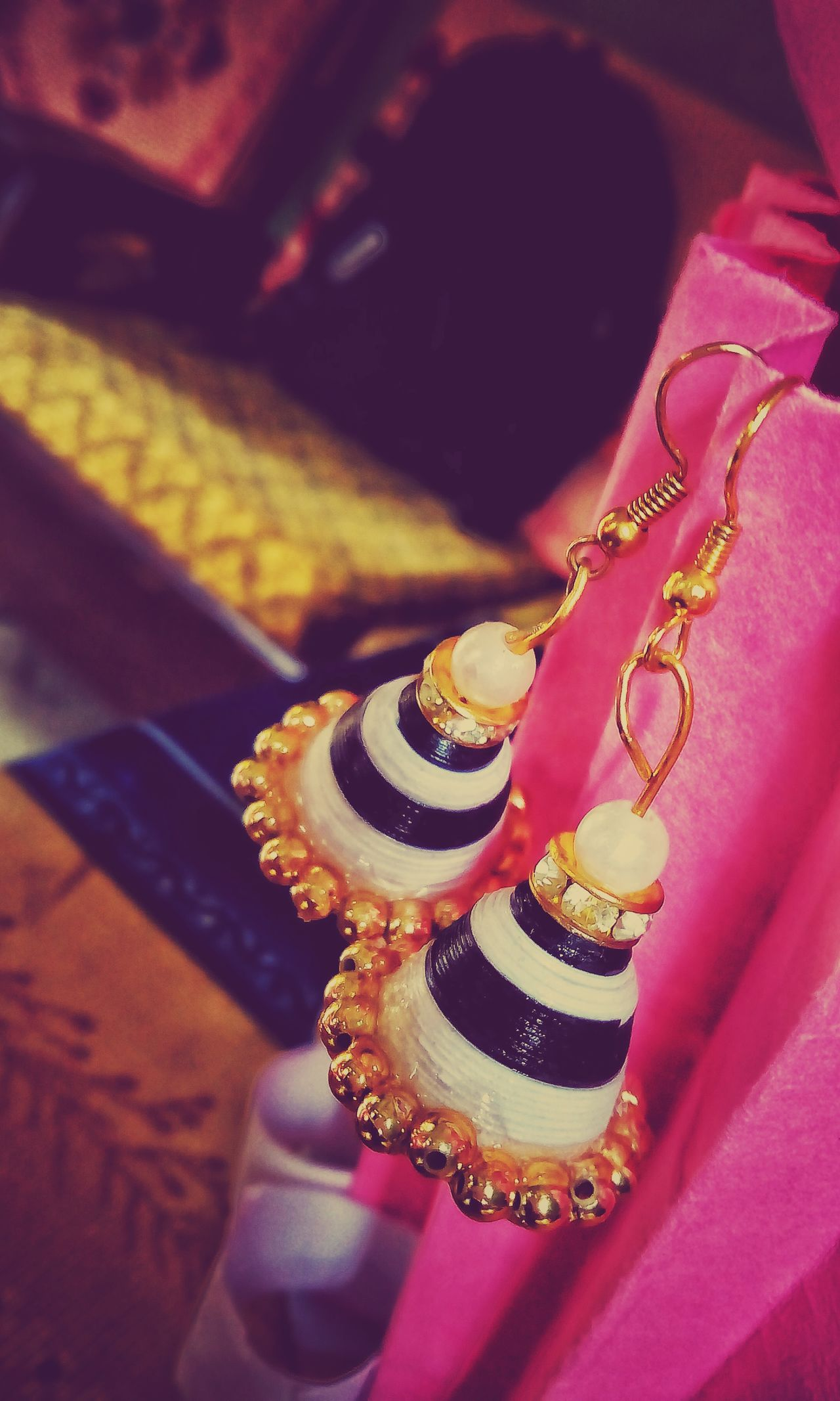 Jewelry Cultures Indoors  Close-up Adult Hand Made Paperwork Jhumka White And Black
