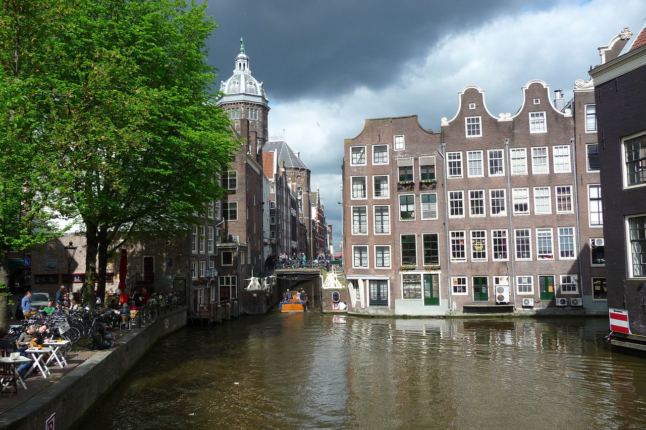 Amsterdam Amsterdam Canal Architecture Bridge - Man Made Structure Building Exterior Canal City City Break Cityscape Netherlands Sky Strange Light The City Light The Netherlands Travel Destinations Water