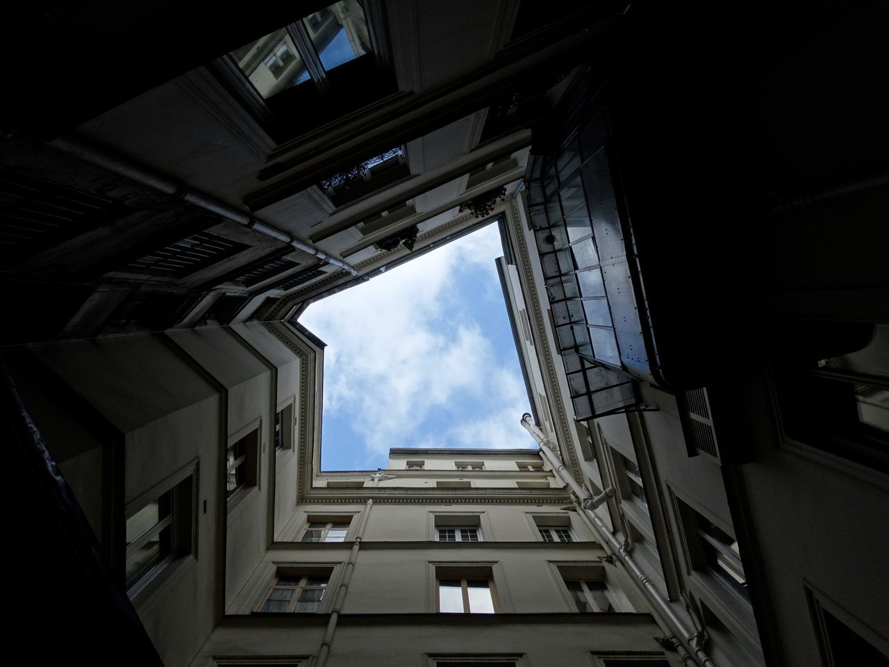 architecture, built structure, building exterior, sky, low angle view, window, cloud - sky, no people, city, day, residential, outdoors