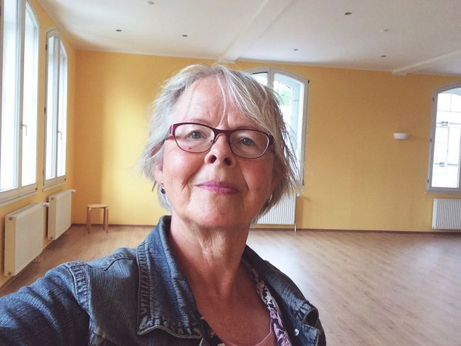 Senior woman in empty room Eyeglasses  Senior Adult Senior Women Real People Indoors  One Person Home Interior Casual Clothing Lifestyles Portrait Women Looking At Camera Sitting Day Beautiful Woman Close-up Adult People