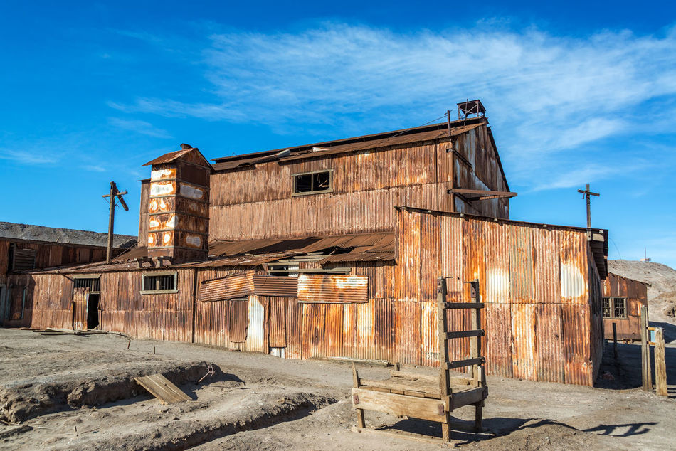 Old rusted building in the UNESCO World Heritage ghost town of Humberstone, Chile Architecture Building Chile Dust Factory Heritage Humberstone Industrial Iquique Landscape Nitre No People Old Outdoors Salitrera Saltpeter Saltpetre Sand Santa Laura Site Sunny Town UNESCO World Heritage Site Village Works