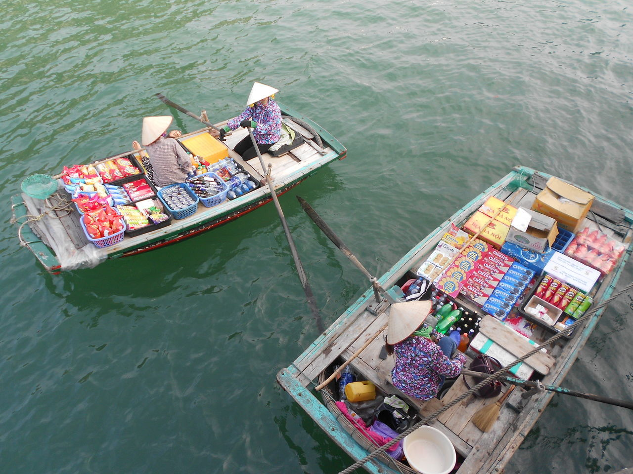 When going on a junk boat in Ha Long Bay, expect to see these woman rowing around your boat (in the middle of the ocean) selling anything from chocolates and cigarettes to warm beer. Boat Ha Long Bay High Angle View Market Nature Nautical Vessel Outdoors Real People Selling Stuff Transportation Vientamese Woman Vietnam Water Here Belongs To Me