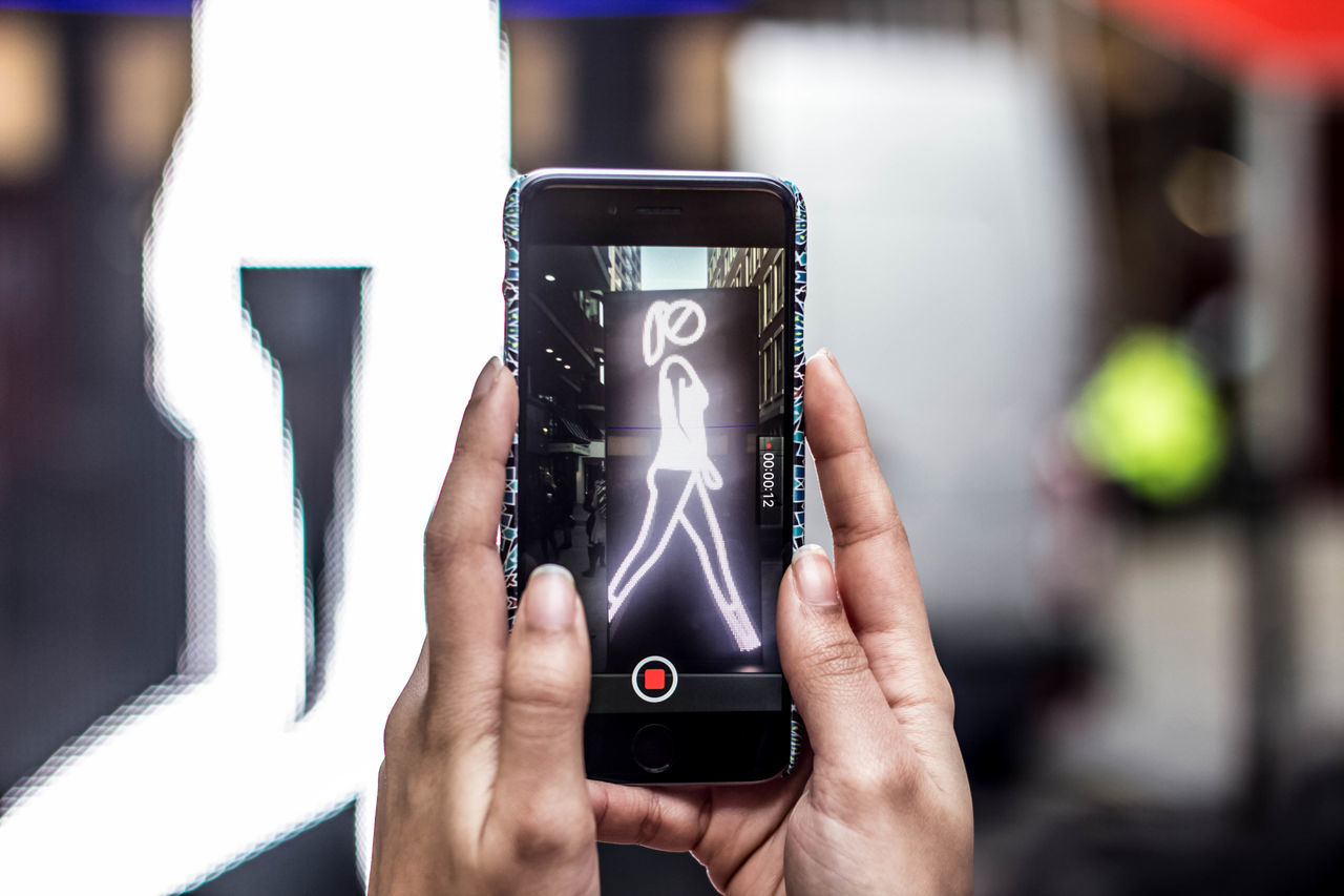 wireless technology, holding, communication, portable information device, technology, smart phone, human hand, mobile phone, focus on foreground, human body part, touch screen, day, real people, one person, close-up, outdoors, people