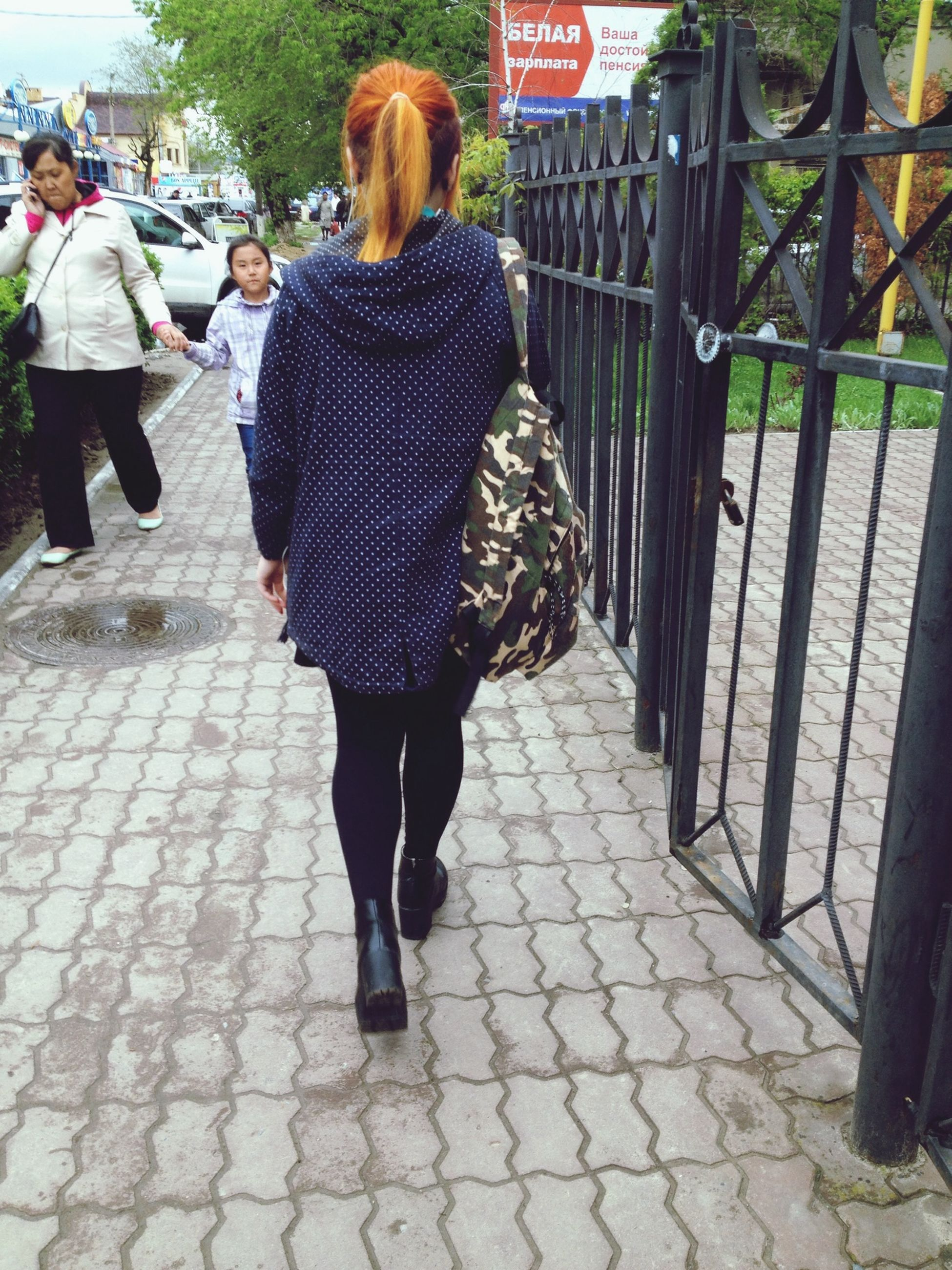 lifestyles, rear view, full length, casual clothing, walking, leisure activity, person, standing, sidewalk, footpath, men, cobblestone, street, city life, day, outdoors, sunlight, incidental people