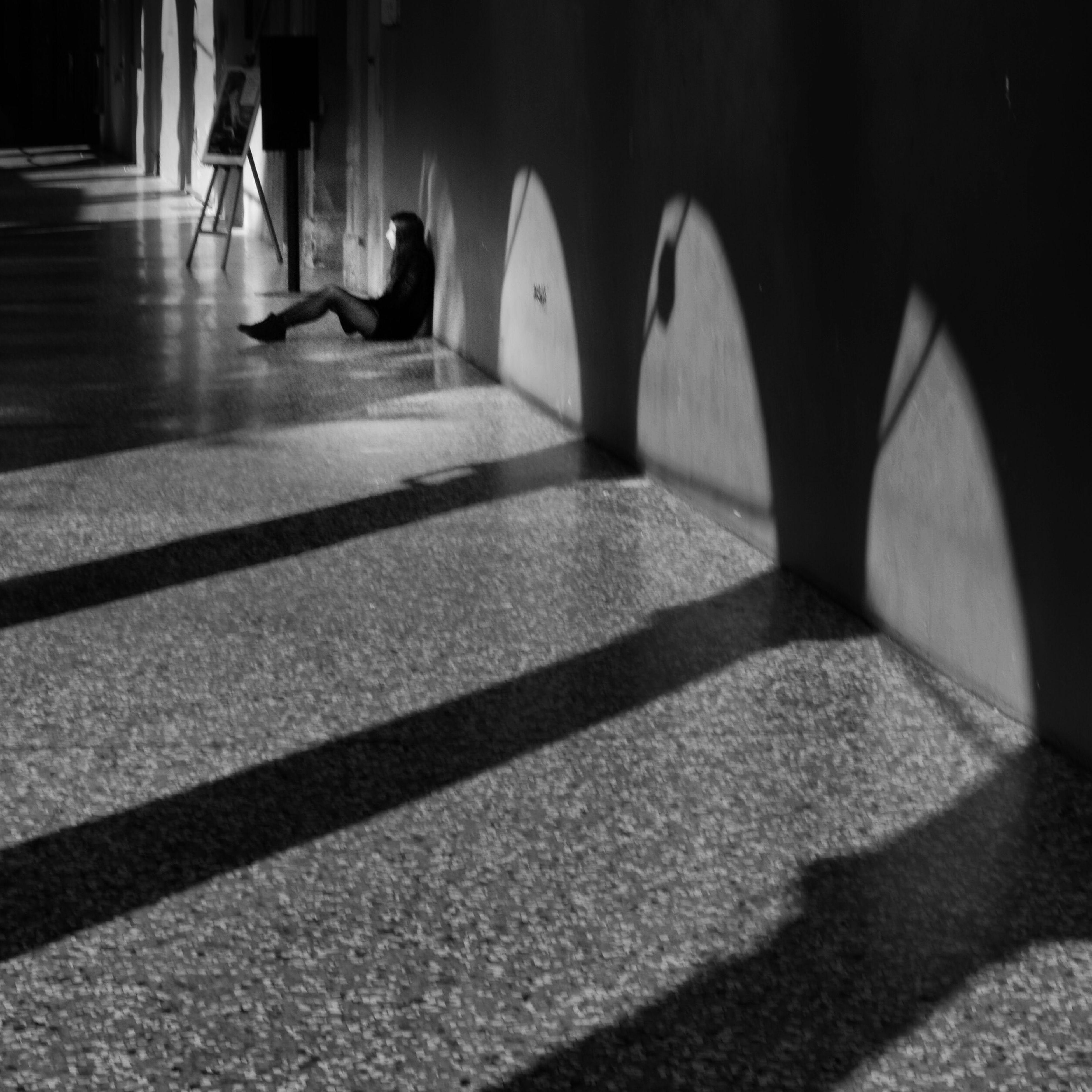 indoors, shadow, tiled floor, flooring, architecture, built structure, sunlight, the way forward, walking, steps, walkway, incidental people, in a row, empty, pattern, corridor, men, cobblestone, day