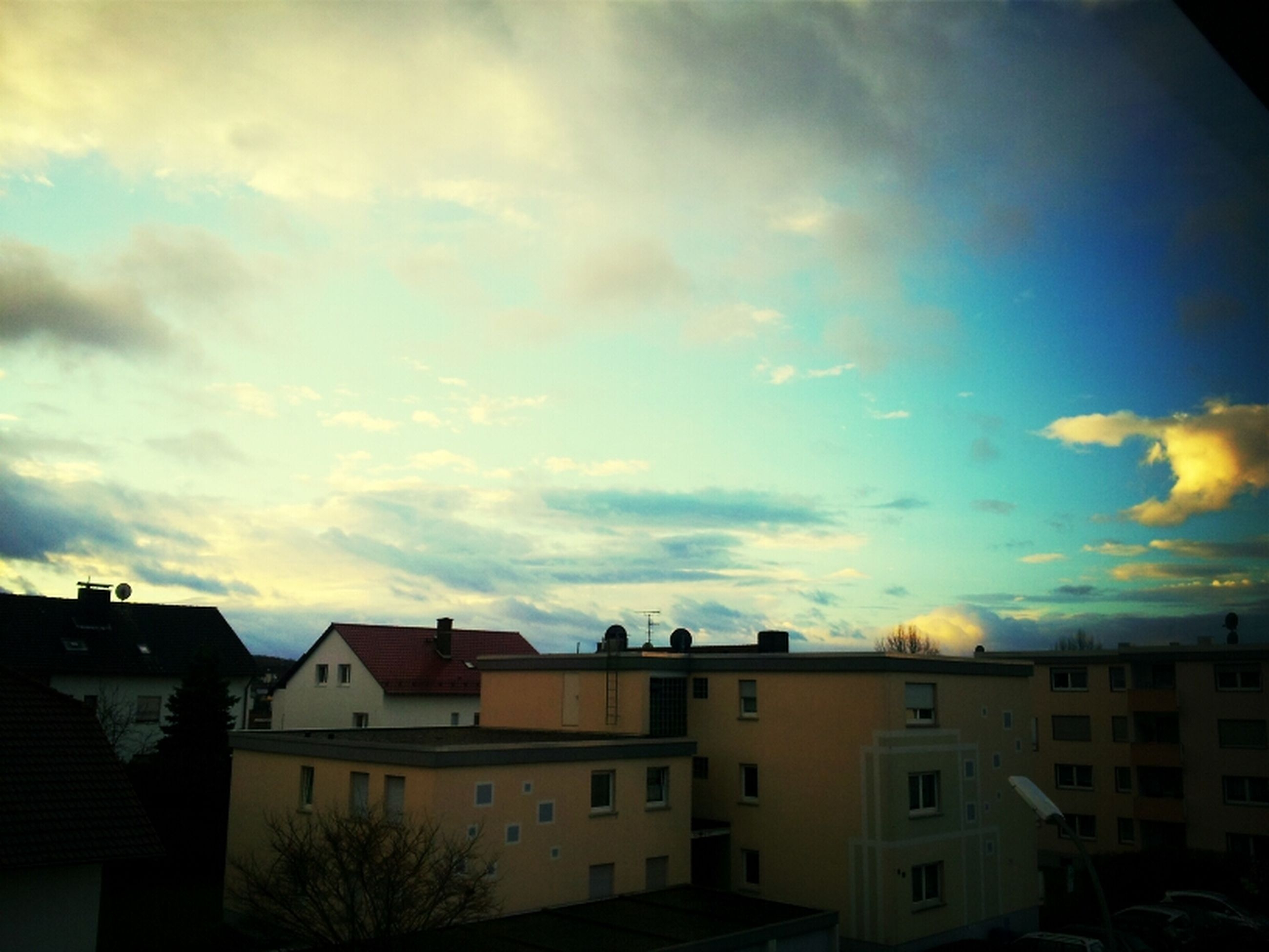 building exterior, architecture, built structure, sky, residential structure, house, residential building, cloud - sky, sunset, residential district, city, cloudy, cloud, town, building, outdoors, no people, roof, dusk, low angle view