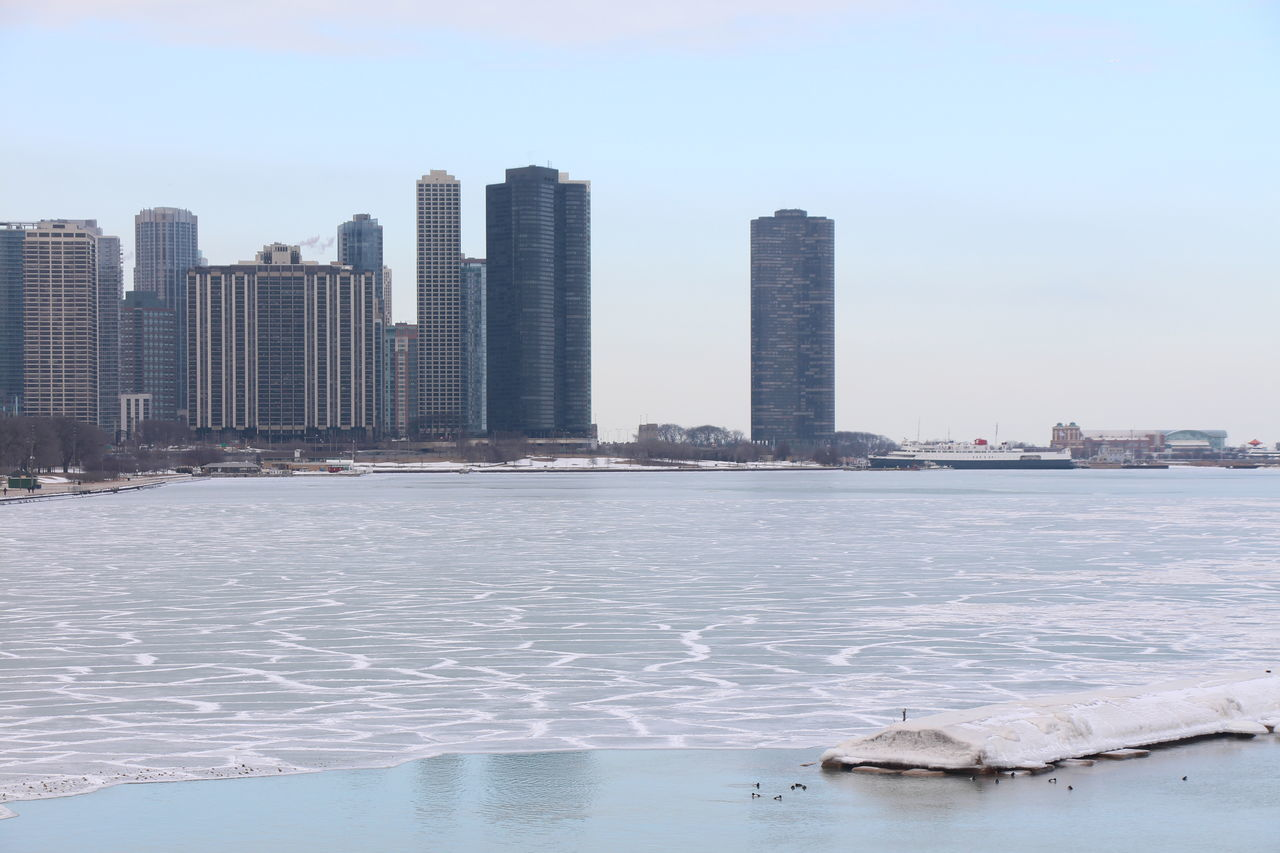 architecture, skyscraper, water, city, waterfront, built structure, building exterior, cityscape, sea, no people, outdoors, day, sky, urban skyline, winter, nature