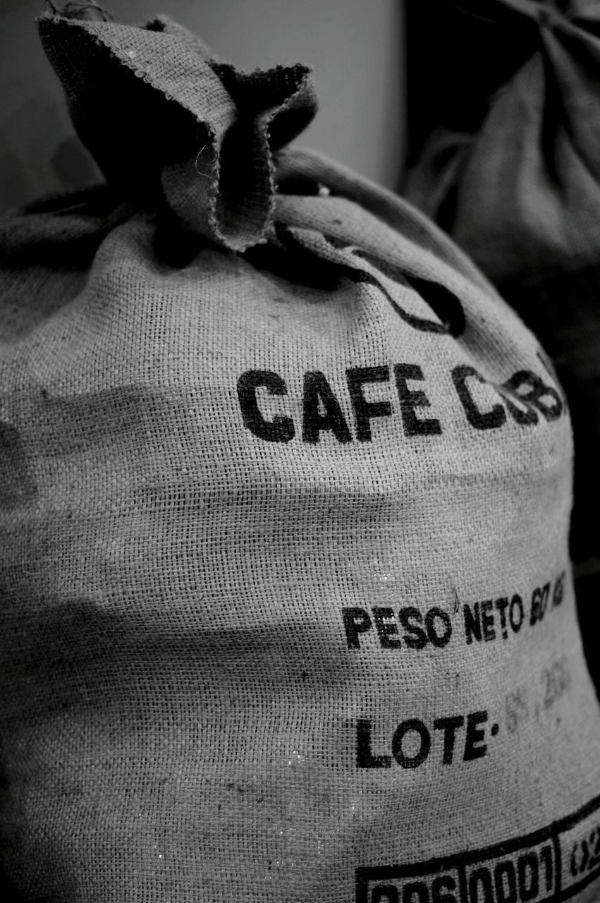 Close-Up Of Jute Sack With Text
