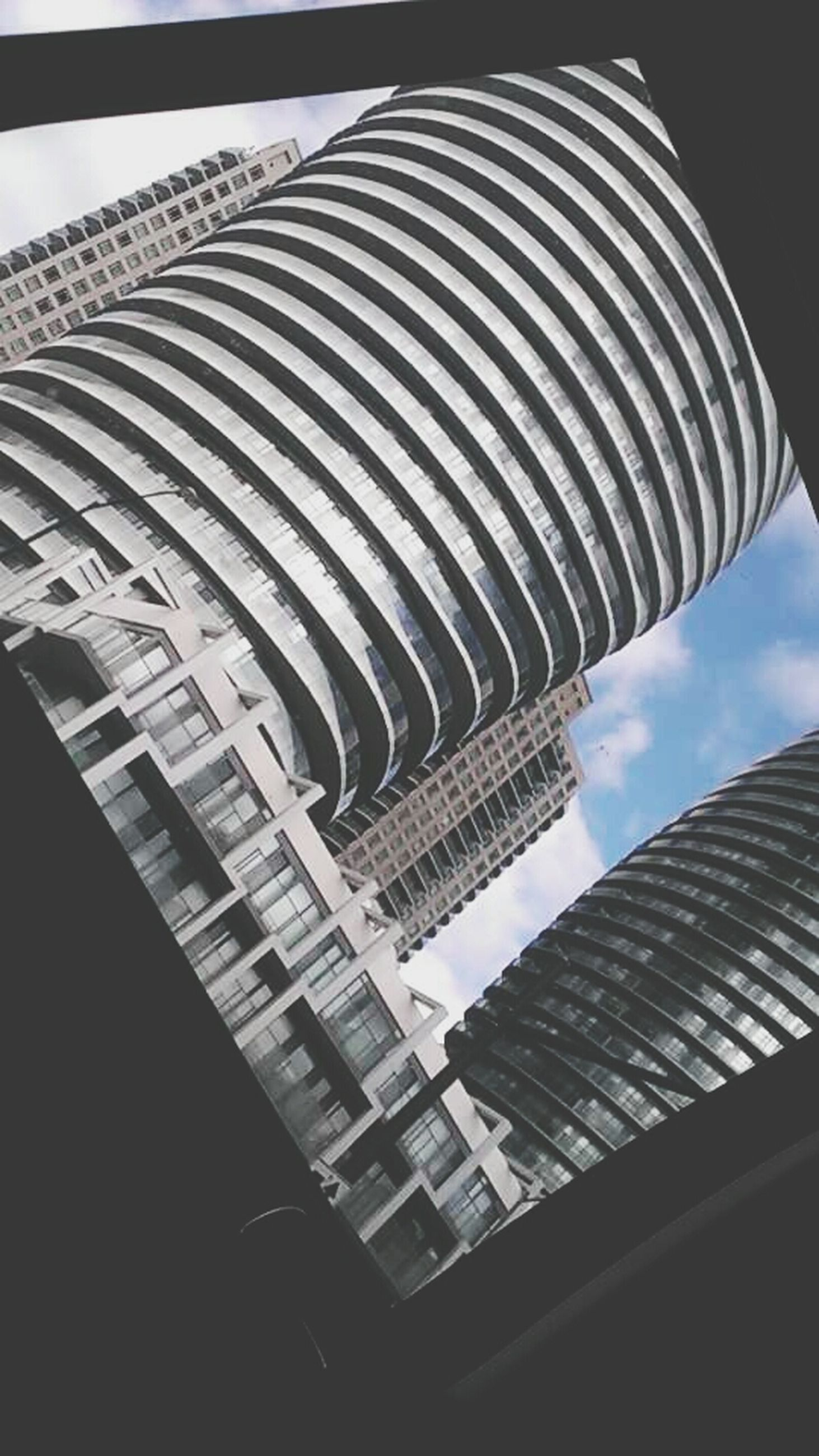 architecture, built structure, building exterior, low angle view, modern, tall - high, skyscraper, famous place, tower, city, international landmark, travel destinations, sky, capital cities, architectural feature, office building, tourism, travel, day, no people