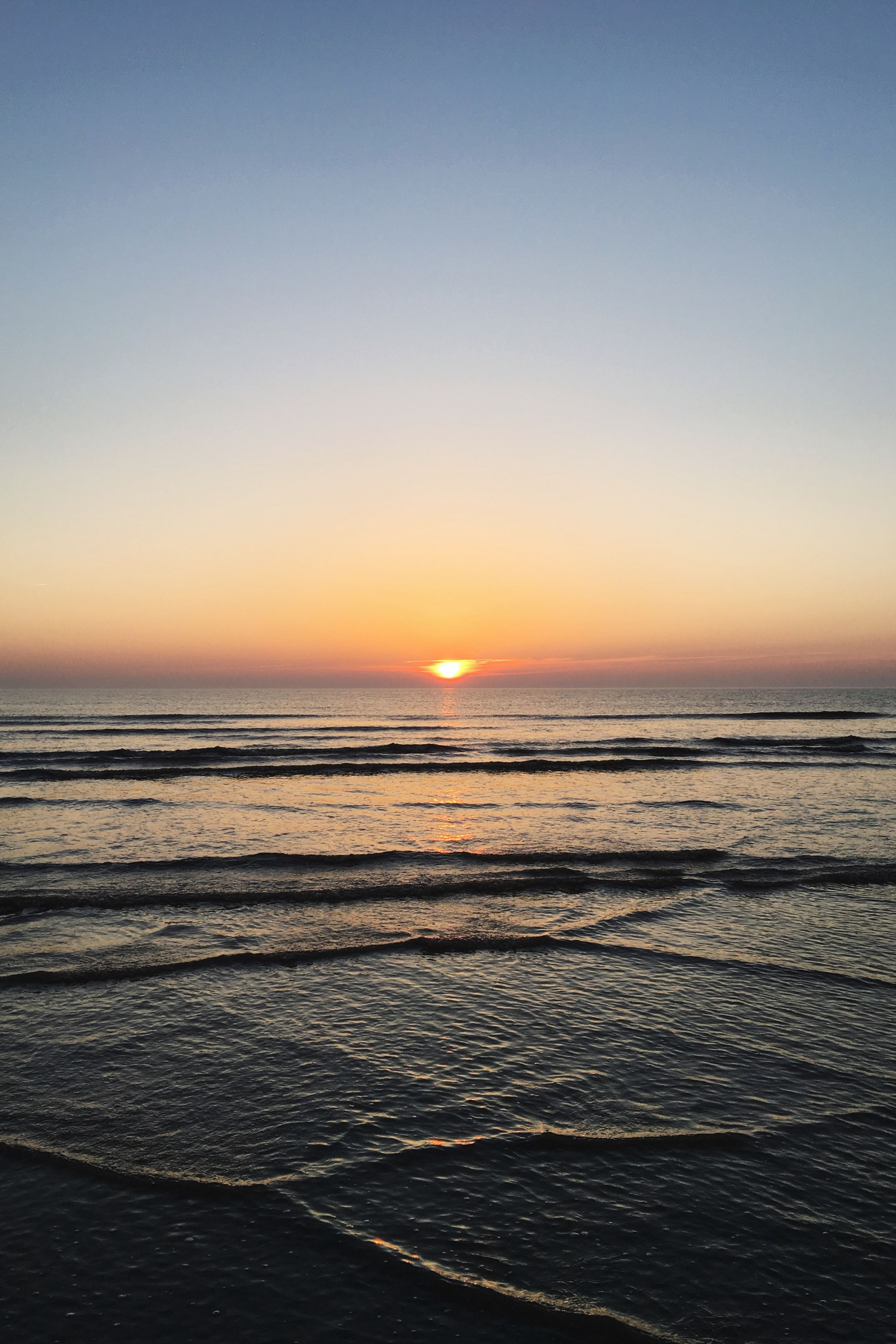 sea, sunset, beach, horizon over water, nature, scenics, beauty in nature, water, tranquility, tranquil scene, idyllic, sand, no people, outdoors, clear sky, sky, day