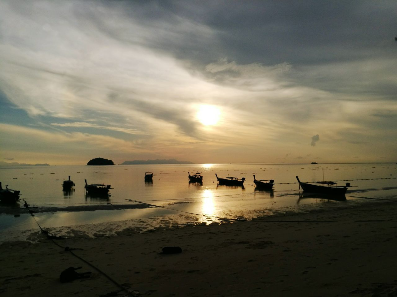 sea, beach, water, sunset, sky, nature, beauty in nature, scenics, shore, sand, cloud - sky, horizon over water, tranquil scene, tranquility, outdoors, no people, silhouette, nautical vessel, day