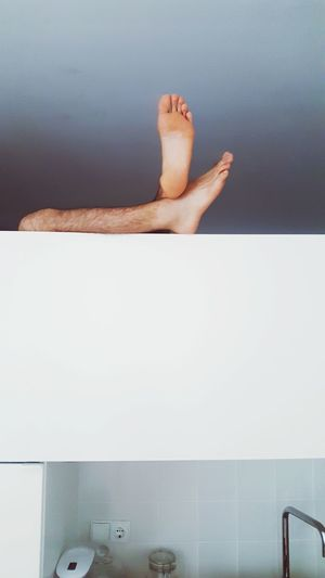 Human Foot Barefoot Human Body Part Human Leg One Person Indoors  Toe People Adult Body Part Portrait EyeEm Selects Bed Kitchen Studio Indoors  EyeEm Vision Lines And Shapes Human Relaxing Sunday Feet Man