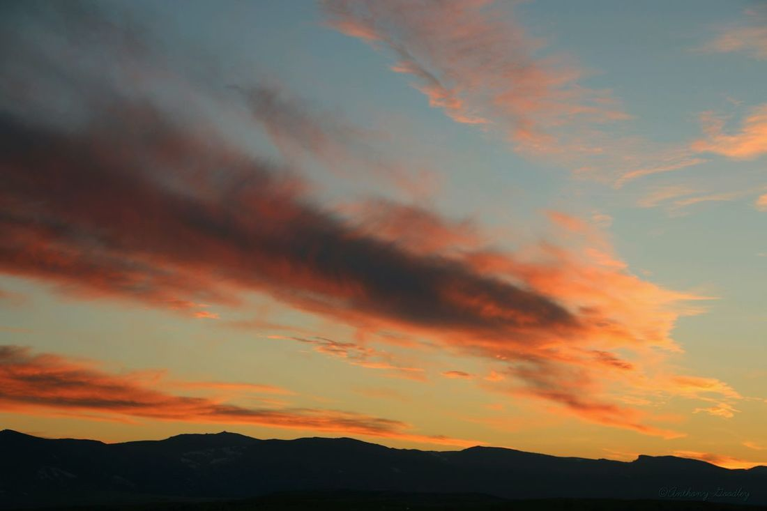 A colorful sunset over the Big Horn mountains as seen from Sheridan Wyoming . Sunset Sunset_collection Clouds And Sky