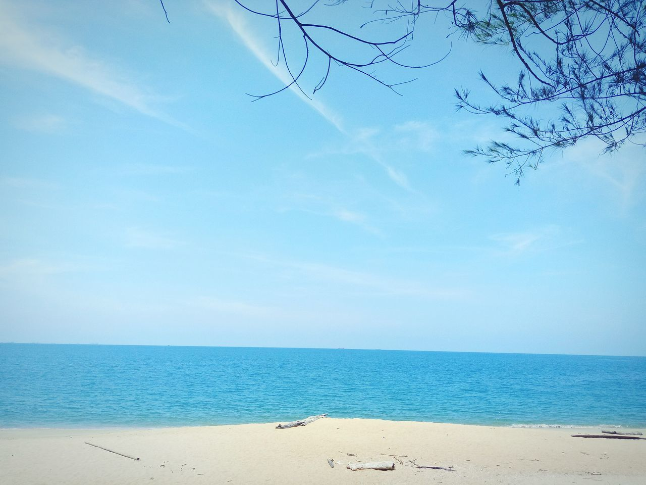 sea, horizon over water, beach, sky, beauty in nature, nature, sand, scenics, tranquil scene, tranquility, water, no people, day, cloud - sky, outdoors, blue
