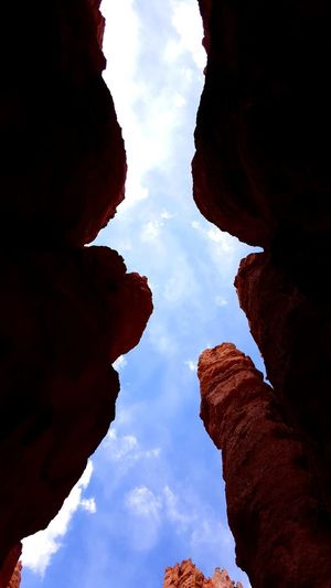 Looking Up Silhouettes of Hoodos Bryce Canyon Utah Blue Sky Window Canyon